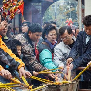 Devotees lighting up their joss sticks while celebrating Chinese New Year in Hong Kong