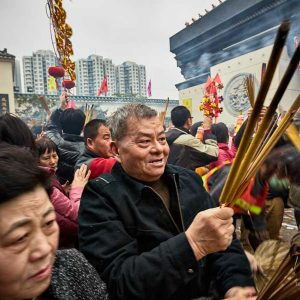 Enthusiastic devotees celebrating Chinese New Year