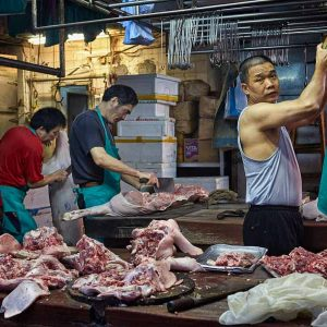 Butchers at work in their stall on Bowrington Road in Hong Kong