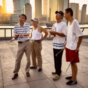 A group of enthusiasts hamming it up while flying kites on The Bund in Shanghai