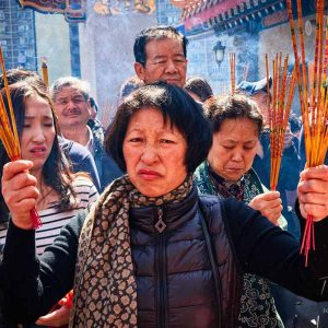 Devotees armed with joss sticks celebrate Chinese New Year in Hong Kong - 2016