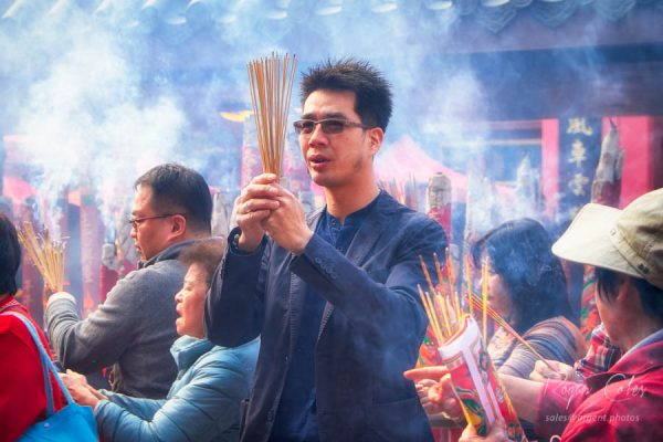 Devotees armed with joss sticks celebrating Chinese New Year in Hong Kong - 2016