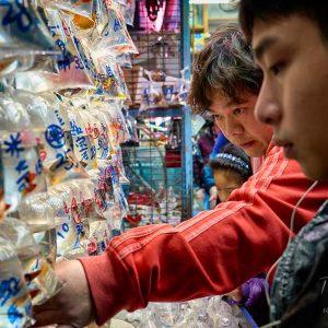 Shoppers viewing tropical fish on Tung Choi Street aka Goldfish Street in Mongkok, Kong Kong