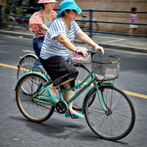 Two ladies on their bicycles commuting in Shanghai #1625