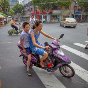 A mother and son commuting on their moped in Shanghai #343